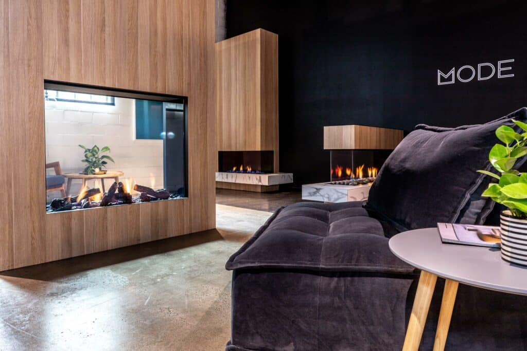 Just Gas Log Fires transparent feature gas fire wall situated in the living room display in the showroom.