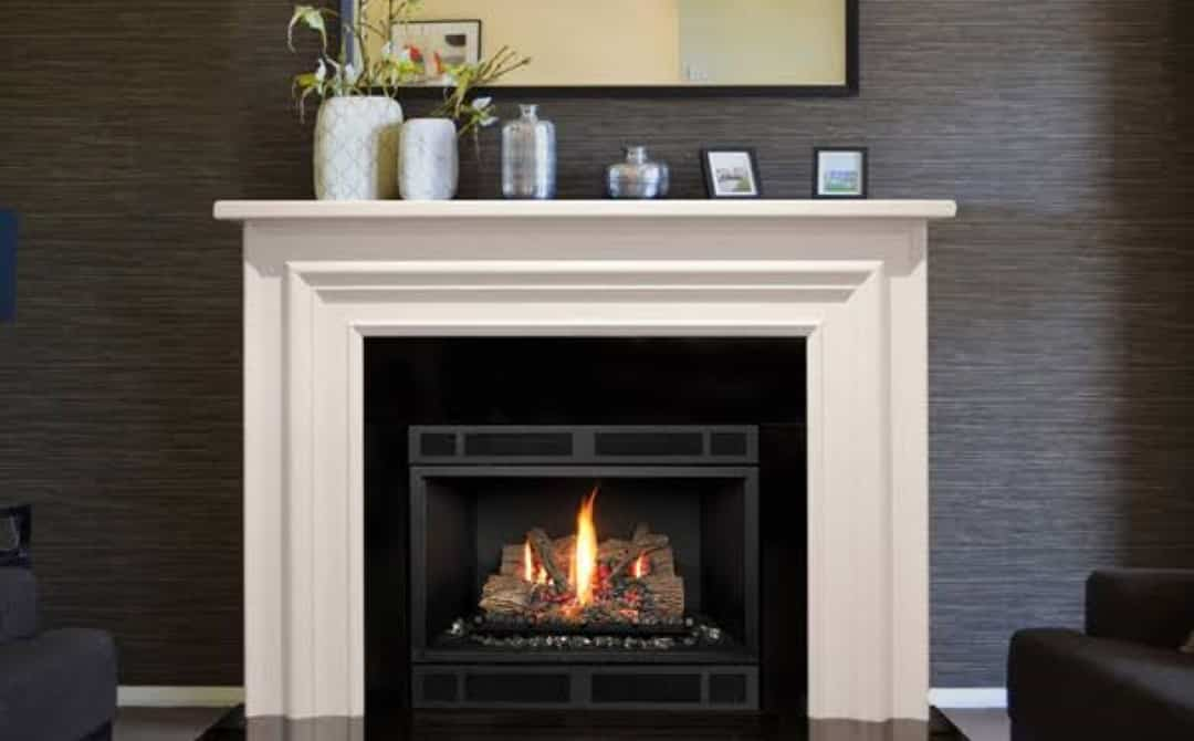 Gas fire with white surrounding mantel