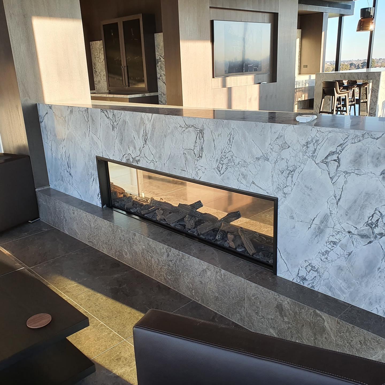 Modern stone finish Escea gas fireplace.